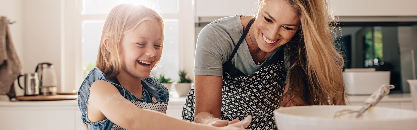 Mother and Daughter Cooking Without Roaches in Kitchen